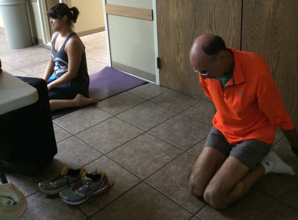 Real husbands try yoga. (Bruce tries some of the poses Marnie Davis showed us at a recent Roadrunners club meeting.)